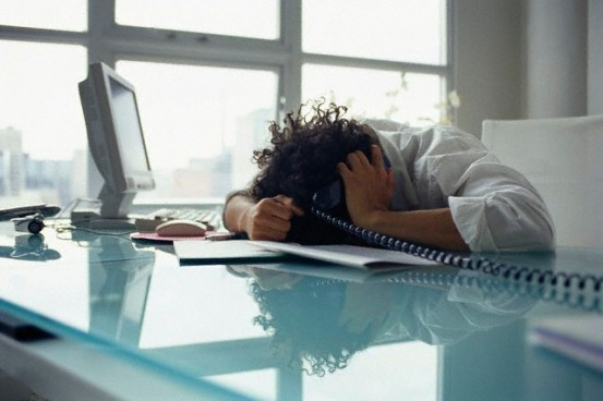 Frustrated Businessman at Desk